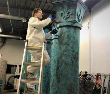 Artist-creating-styrofoam-pillars-2